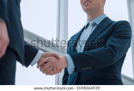 handshake of business partners after a favorable trade deal