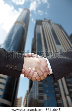 Handshake of business partners, against the backdrop of the city.