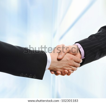 Handshake of business partners on the background of an office building