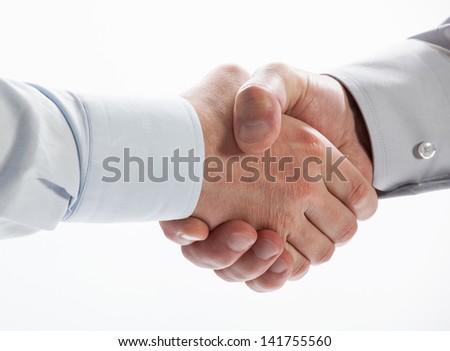 Handshake of business partners on white background