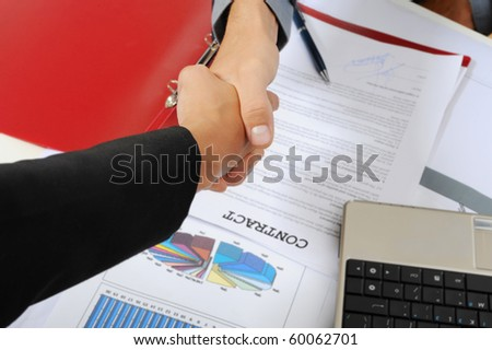 Handshake of business partners, when signing documents.