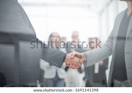 handshake of business people in the conference room