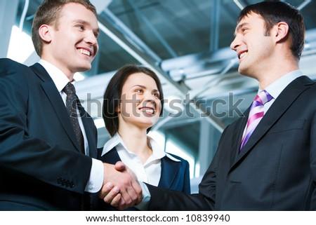 Handshake of business people struck a bargain