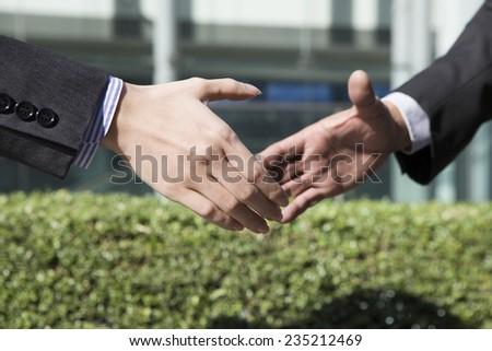 Handshake of businessman to celebrate the success