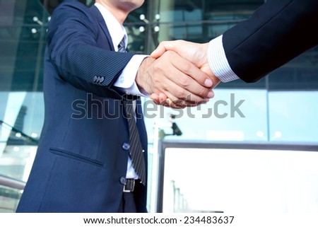 Handshake of businessmen success congratulation greeting & business partner concepts