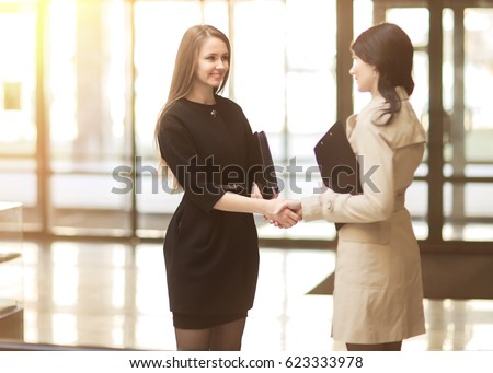 handshake of the company manager and the client in the lobby of the modern office #623333978