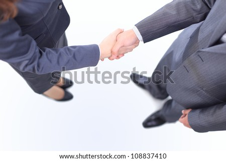 Handshake of the two businessmen, agreed in the contract. Isolated on a white background.