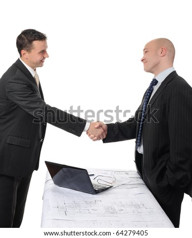Handshake of two business partners after signing a contract.
