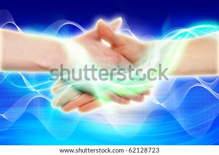 Handshake of two business people against the sky. Symbol of successful business