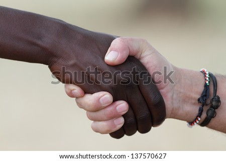 Handshake of two people on a deal