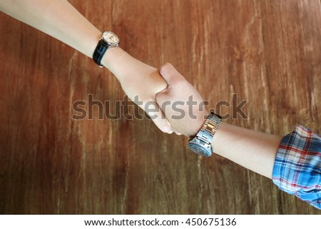 Handshake of two young businessmen, Business people. Business handshake for closing the deal after contract between companies. Good business partner trust and relationship.