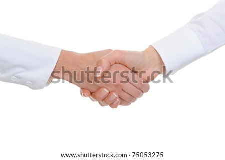 Handshake of women business partners in the office. Isolated on white background