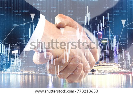 Handshake on abstract night city background with business chart. Teamwork and finance concept. Double exposure