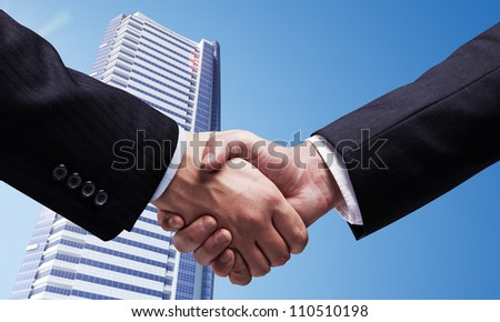 handshake on  background of skyscraper