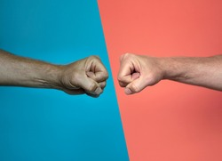 handshake or fist bump on blue & red background