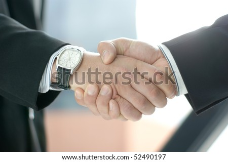 Handshake over abstract modern business background