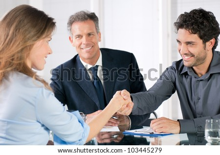 Handshake to seal a deal after a job recruitment meeting