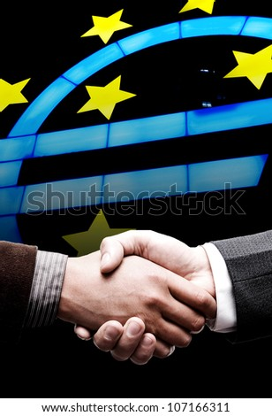 Handshake with the euro sign in the background