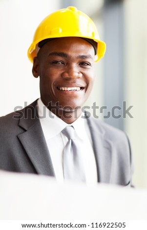 handsome african american architect with construction plan - stock photo