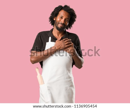 Handsome african american baker doing a romantic gesture, in love with someone or showing affection for some friend #1136905454