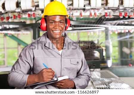 handsome african american blue collar worker portrait inside factory