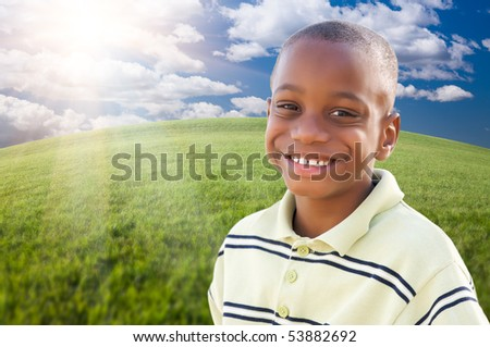 Handsome African American Boy Over Clouds, Sky and Arched Horizon of Grass Field.