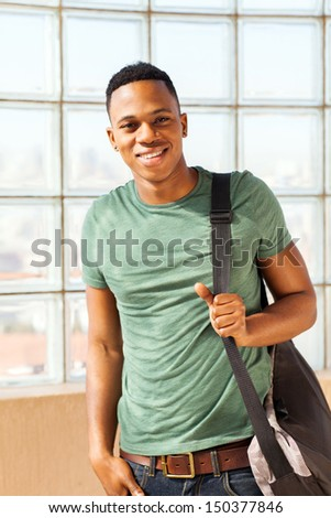 handsome african american boy with a bag