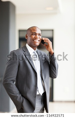 handsome african american business executive talking on cellphone
