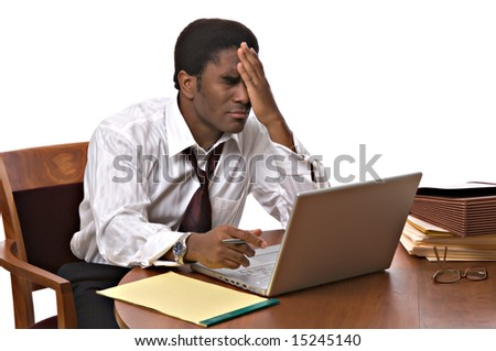 Handsome African-American businessman working on a laptop