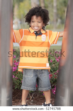 Handsome African American child in the outdoors