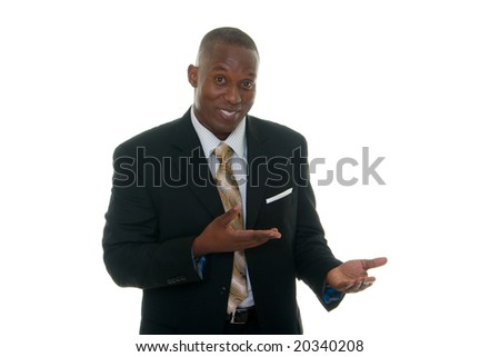 Handsome African American man in a black business suit gesturing as if to demonstrate a product sample.