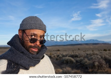 Handsome African American man outdoors - with copy space