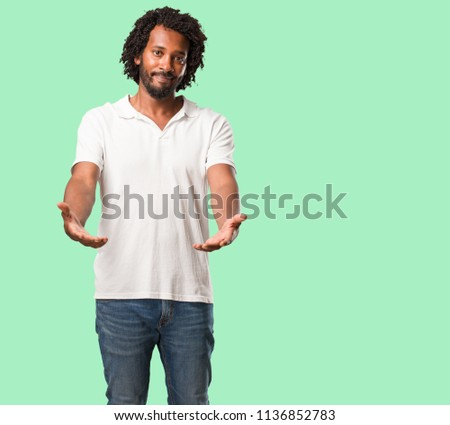 Free photos portrait of a young african american business man handsome african american reaching out to greet someone or gesturing to help happy and excited m4hsunfo