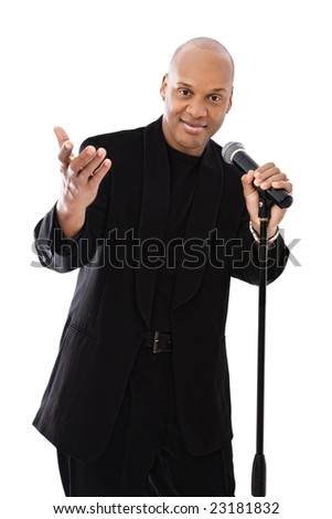 handsome african american singer with microphone on white