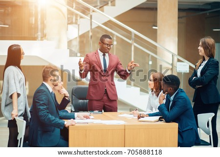 handsome african businessman with group of businesspeople