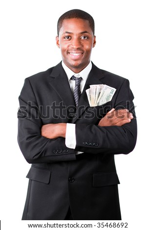 Handsome Afro-American businessman with folded arms and dollars in a pocket