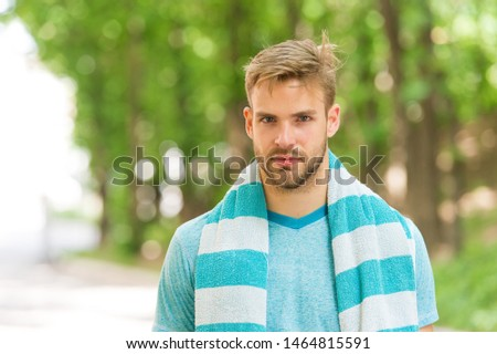 Handsome and athletic. Handsome man in summer style on summer day. Caucasian guy with sexy beard on handsome face and stylish blond hair on natural landscape. Casual and handsome.