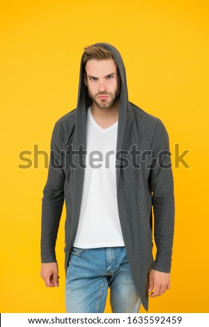 Handsome and casual. Handsome man yellow background. Young guy wear hooded sweatshirt. Handsome model with fashion look. Fashion and style. Handsome and confident.