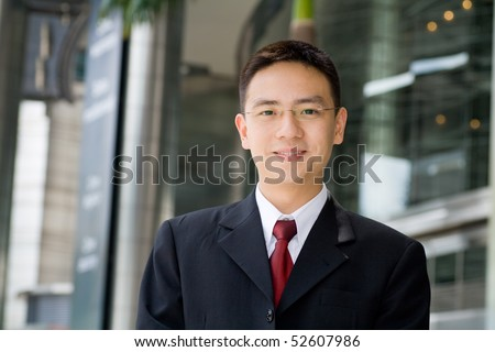 Handsome and good looking asian business man smiling