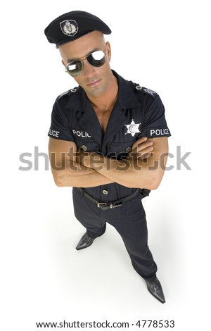 Handsome and proud man in policeman costume. Standing with crossed hands. Isolated on white in studio. Front view, whole body #4778533