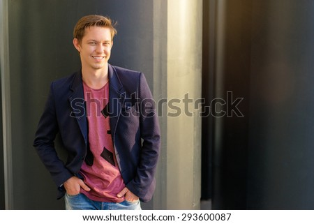 Handsome and relaxed. Young man in casual wear standing outdoors #293600087