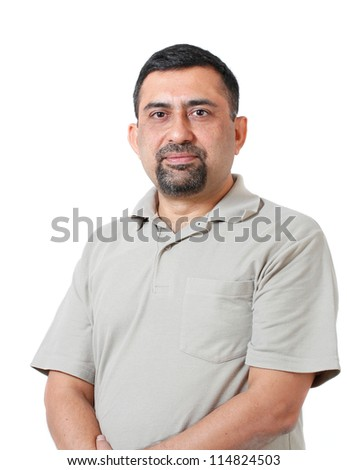 Handsome and smart indian corporate manager of middle age looking with confidence and determination.The person is looking relaxed with causal attire & photo is shot in studio with white background