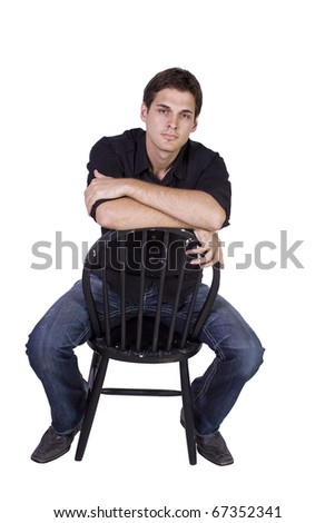 Handsome and stylish model sitting on chair - Isolated