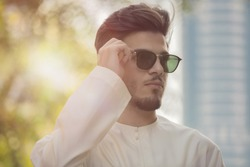 handsome Arab model man wearing sunglasses