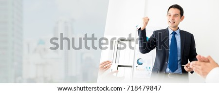 Handsome Asian businessman leader during a successful meeting empowered by his colleagues - panoramic web banner with copy space