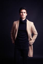 handsome asian fashion looking man posing in studio on black background, lifestyle modern people concept