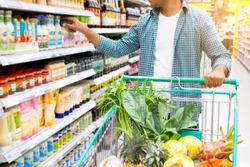 Handsome asian man shopping in a supermarket. shopping concept