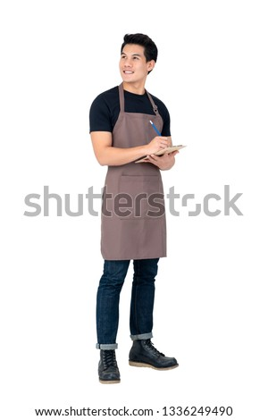 Handsome Asian man wearing apron as a barista standing in white background