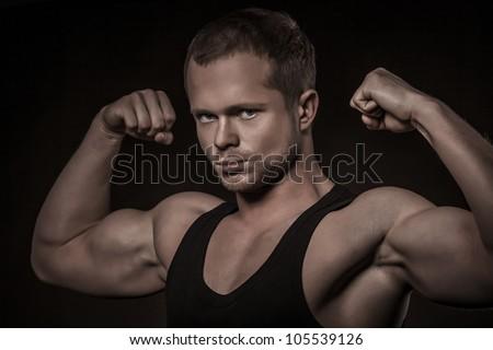 Handsome athlete on a black background