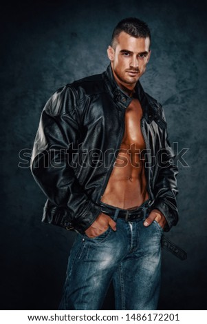 Handsome Athletic Male Model Wearing Leather Jacket on Naked Torso
